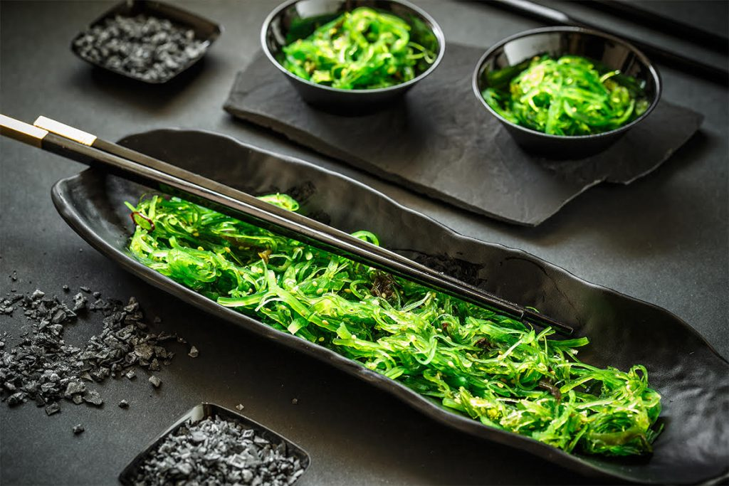 A delicious fresh seaweed salad on black background